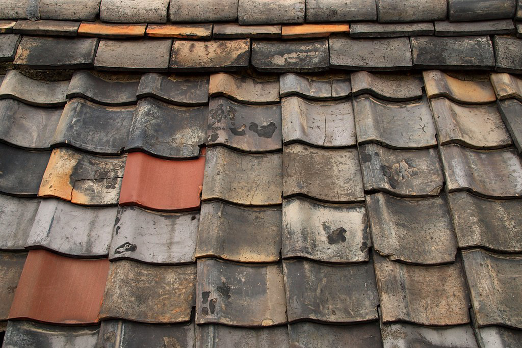 Old, broken clay tile roof